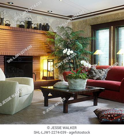 LIVING ROOM - Oriental decor. Brick fireplace, Arts and Crafts style, black teapots and baskets on mantel, oriental lantern, mortise and tenon coffee table