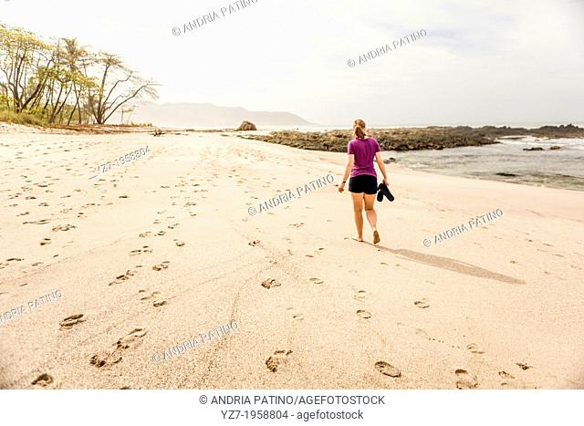 Woman walking on Playa Carmen, Costa Rica