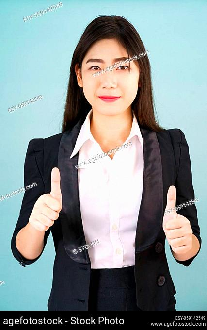 Asian business women in suit and thump up hand sign