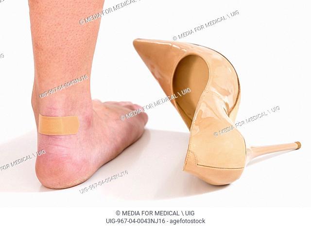 Band aid foot woman
