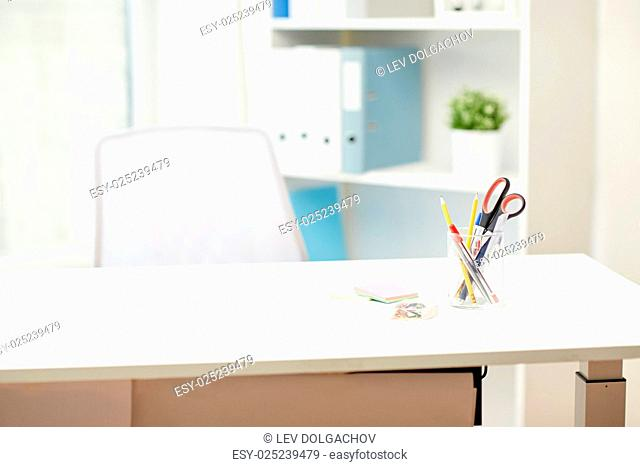 business, interior, workplace and education concept - stationery on office table
