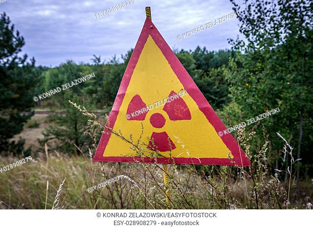 Warning sign in so called Red Forest area surrounding Chernobyl Nuclear Power Plant, Zone of Alienation, Ukraine