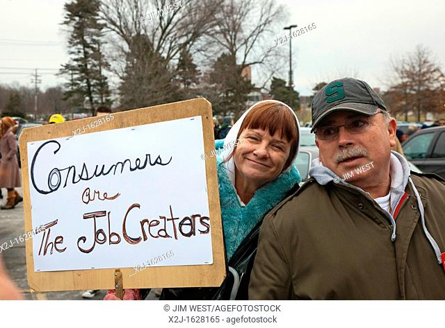 Superior Township, Michigan - A couple with their sign about job creation at a rally protesting Michigan's emergency financial manager law