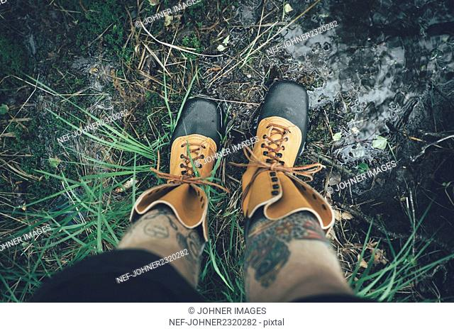 Man wearing hiking boots, low section