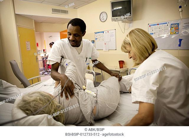 Photo essay at La Croix Saint-Simon Hospital, Paris, France. Night shift nurse and ancillary hospital staff