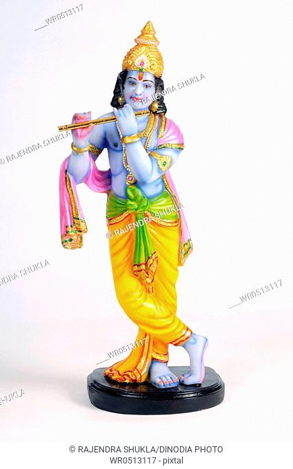 Statue of lord krishna playing flute , India