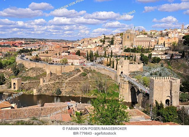 View of the old part of Toledo and the Tajo River, Puente de San Martín in the foreground, Toledo, Spain