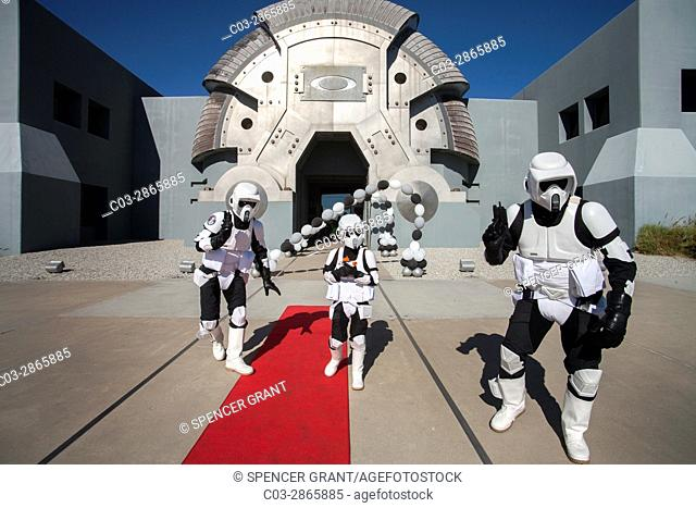 Actors costumed as Stormtroopers from the futuristic science fiction movie Star Wars accompany a costumed boy from the futuristic Oakley Headquarters in...
