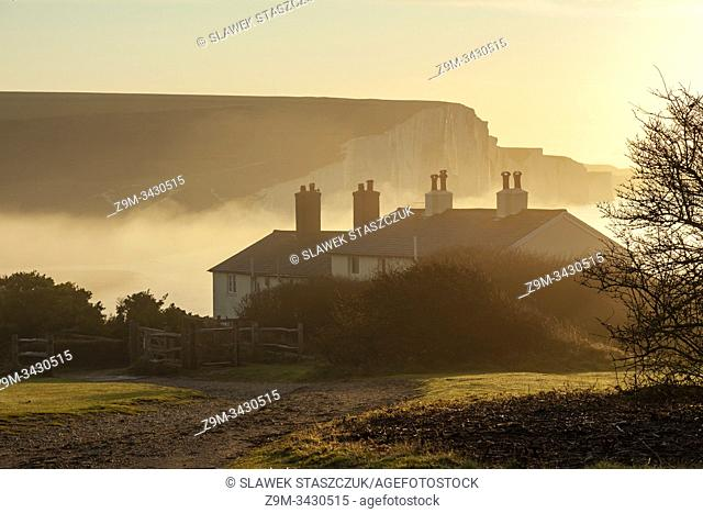 Autumn sunrise at Coastguard Cottages in East Sussex, England. South Downs National Park