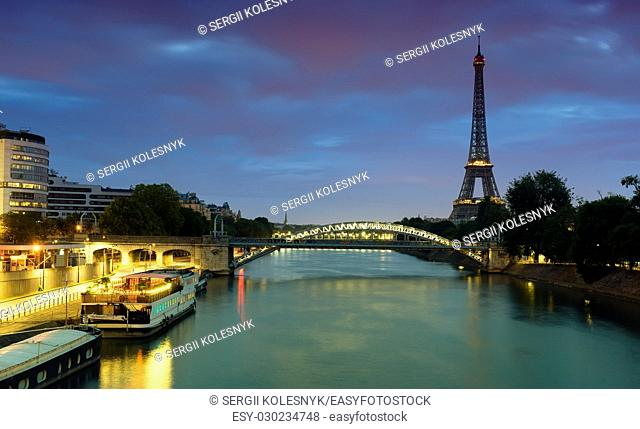 Cityscape of Paris with the view on Eiffel Tower and Pont Rouelle in early morning, France