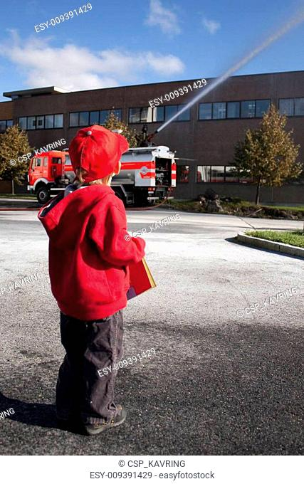 Child (3 years old) looking at a fire engine