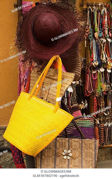 Necklaces and hand bags at a market stall, Cinque Terre National Park, Via Roma, Vernazza, La Spezia, Liguria, Italy