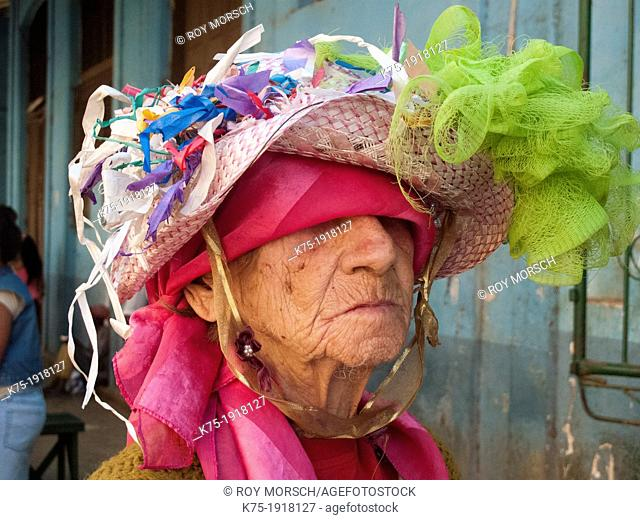 Portrait of a very colorful senior woman in Havana