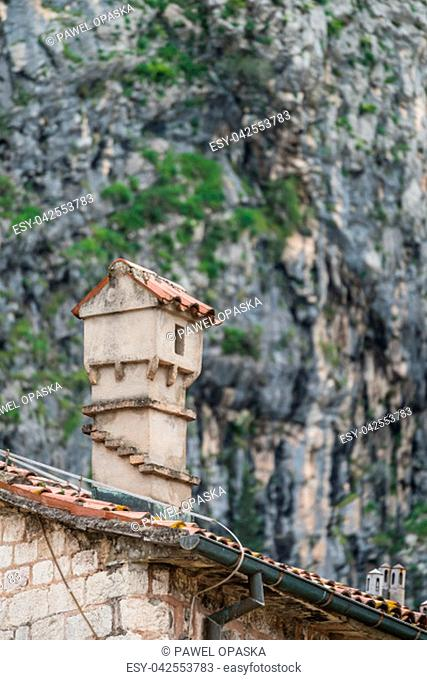 Small chimney on the roof of the historical residential building in the Kotor Old Town, Montenegro