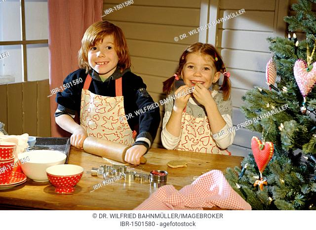 Christmas bakery, children baking cookies