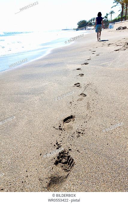 A woman walks on the beach.Recreation vacation