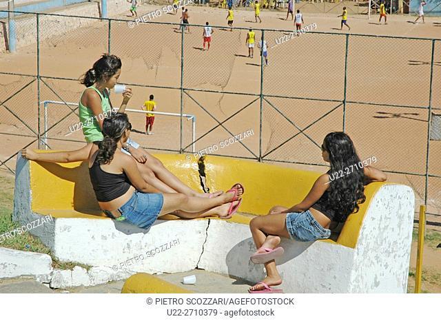 Salvador de Bahia, Brazil: girls watching men playing soccer at Praia da Boa Viagem