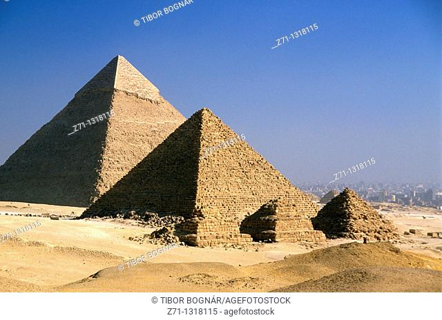 Khafre's Pyramid (in background) and Menkaure's Pyramid with its subsidiary Queen's Pyramids. Giza, Cairo, Egypt