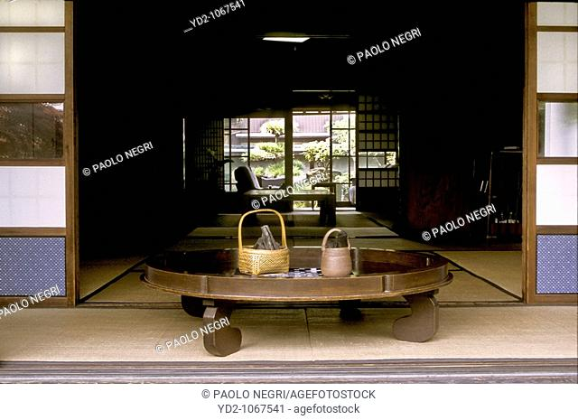 round table with bambu basket and binchotan charcoal, private house, Japan