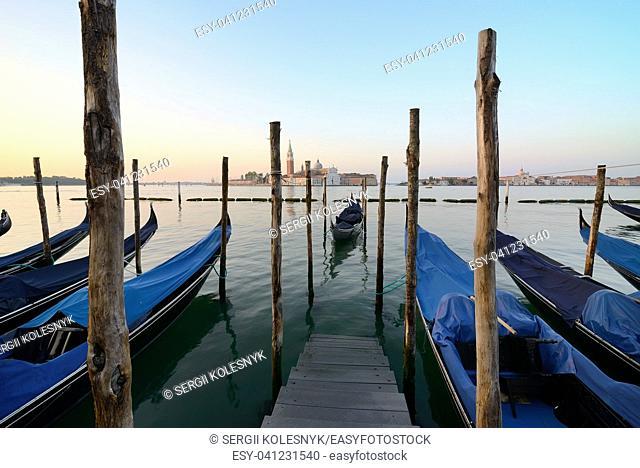 Condolas and wooden pier in Venice, Italy