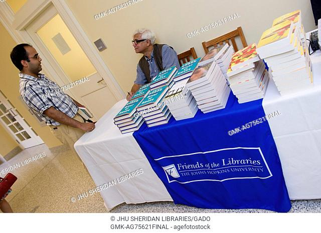 "Bengali Indian author Amitav Gosh signs copies of his novel """"River of Smoke"""" after reading from the book at Johns Hopkins University's Homewood campus in..."