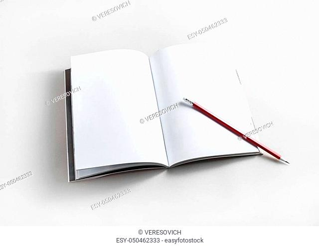 Blank opened brochure and pencil on paper background. Responsive design template. Mock up for your design