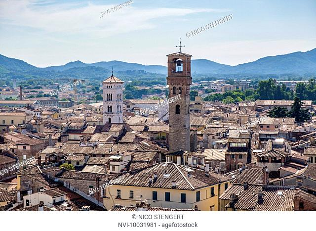View to the clock tower Torre delle Ore and the church of San Michele in Foro, Lucca, Tuscany, Italy