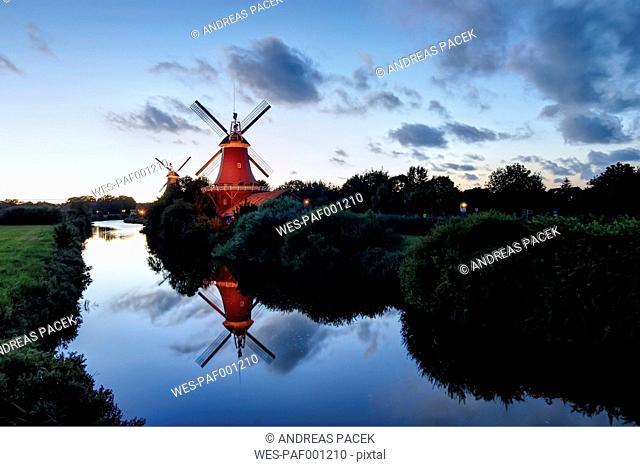 Germany, Lower Saxony, Greetsiel, traditional windmills in the evening light