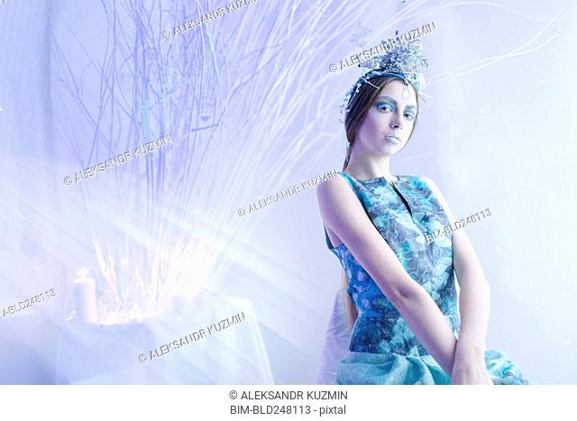 Ethereal woman wearing blue dress and makeup