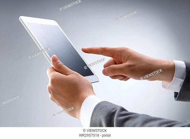 Hand holding a tablet computer