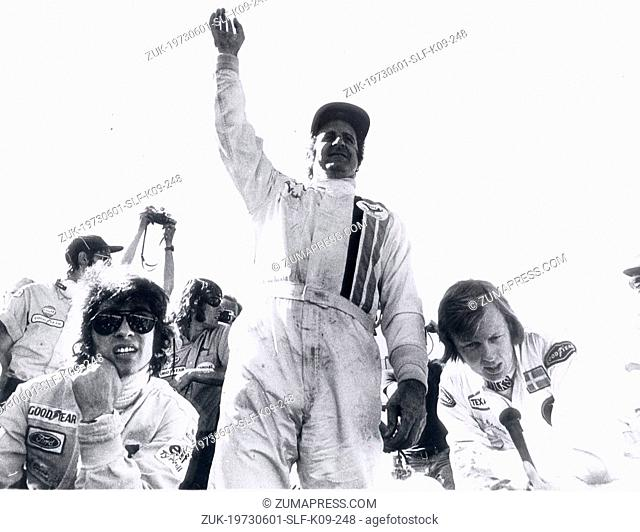 Jun 01, 1973 - Smaland, Sweden - DENNY HULME raising his hand after he won the Swedish Grand Prix in Anderstorp. On his left is third place winner FRANCOIS...