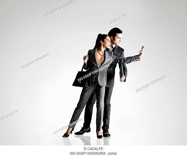 Business couple using cell phone