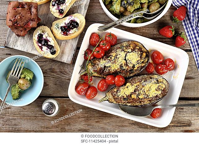 Stuffed aubergines, potato salad, baguette canapés and chocolate cake