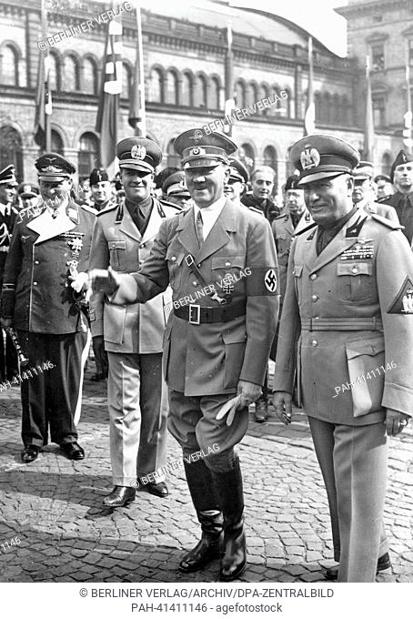 The image from the Nazi Propaganda! shows Adolf Hitler and the Italian Prime Minister Benito Mussolini (r) after his arrival upon leaving Munich Central Station...
