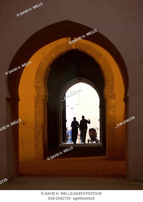 Silhouette of people walking through an archway in Casablanca, Morocco