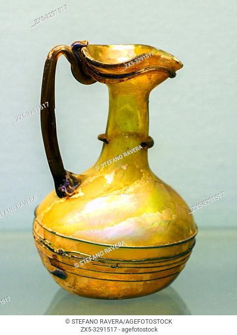 Blown glass double-nodied jug. about AD 100-200 from Syria