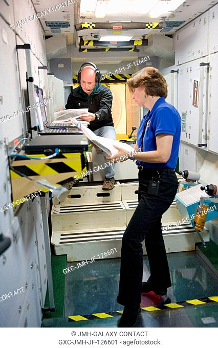 NASA astronauts Scott Kelly, Expedition 25 flight engineer and Expedition 26 commander; and Catherine Coleman, Expedition 2627 flight engineer