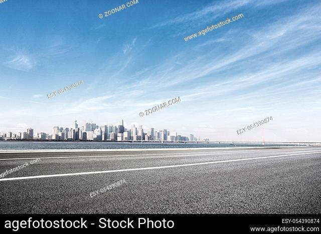 cityscape of hangzhou in blue cloud sky from empty road