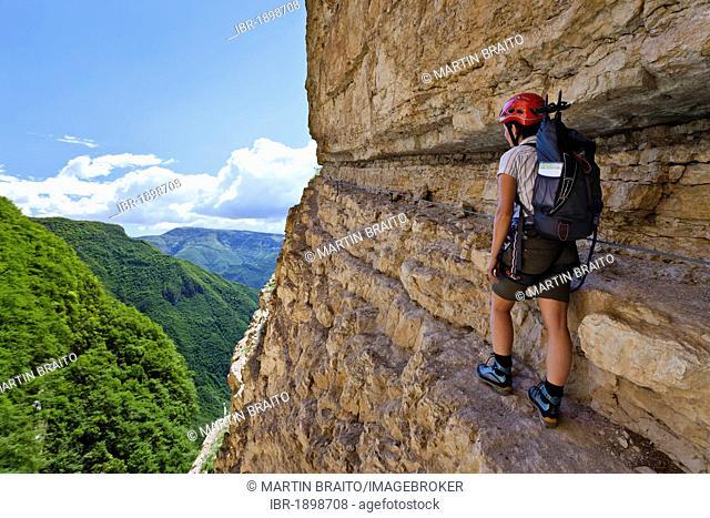 Climber on the Gerardo Sega fixed rope route on Mounte Baldo mountain above Avio, Lake Garda region, province of Trento, Italy, Europe