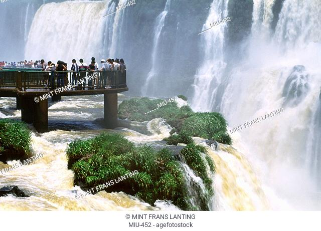 Tourists at waterfalls, Iguacu National Park, Brazil