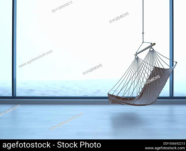 hanging chair in an empty room on light parquet floor. Natural light from the window, reflection on the floor. Copy space. snow outside the window