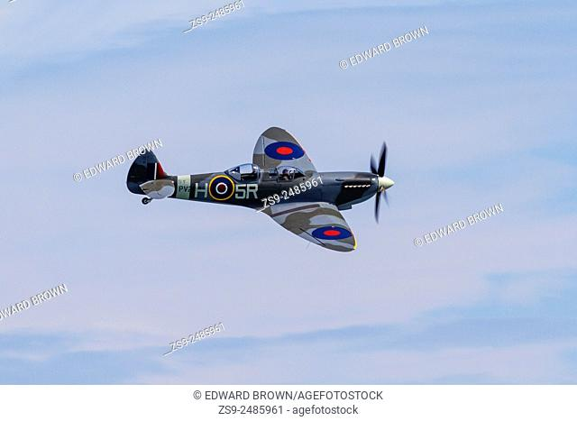 Spitfire flying over East Sussex at the Eastbourne Air Show, England, UK. Editorial use only. No releases available