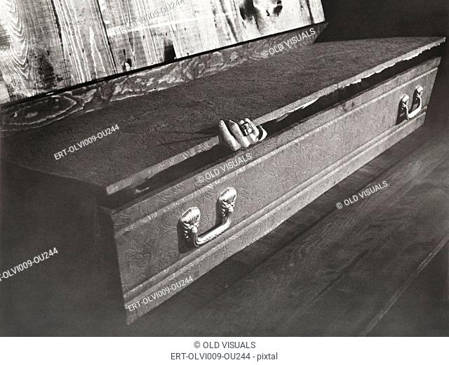Hand reaching out of coffin