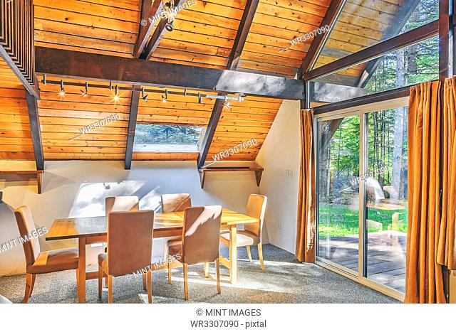 Dining table and windows in rustic dining room