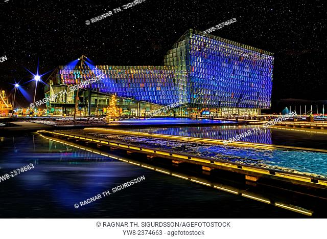 Situated on the boundary between land and sea, Harpa is a gleaming modern building reflecting both sky and harbor. The glass facade