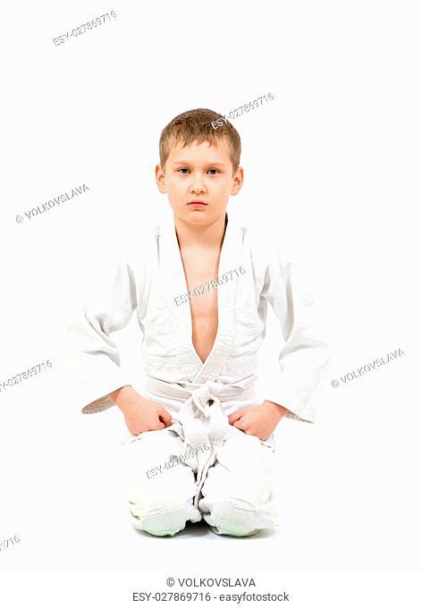 Karate boy in white kimono fighting