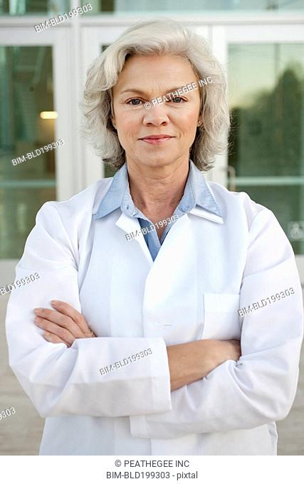 Smiling doctor standing outdoors