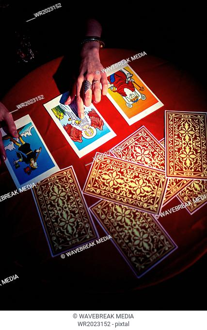 Overhead view of fortune teller using tarot cards