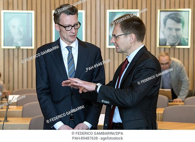 Peter Frank (R), the federal attorney general, talks to Sven Wolf (SPD) before testifying in front of an investigation committee of the North Rhine-Westphalian...