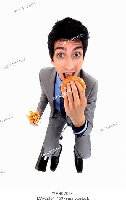 A businessman devoring a burger